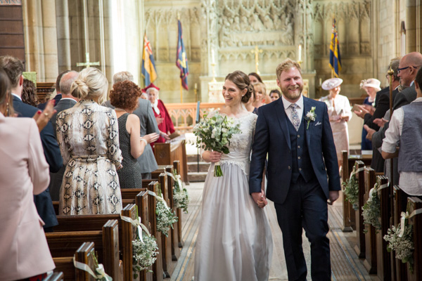 Bride and Groom walking out of church at Wentworth Church wedding