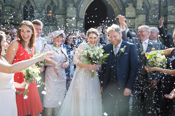 Bride and Groom with their family throwing confetti at Wentworth Church Wedding