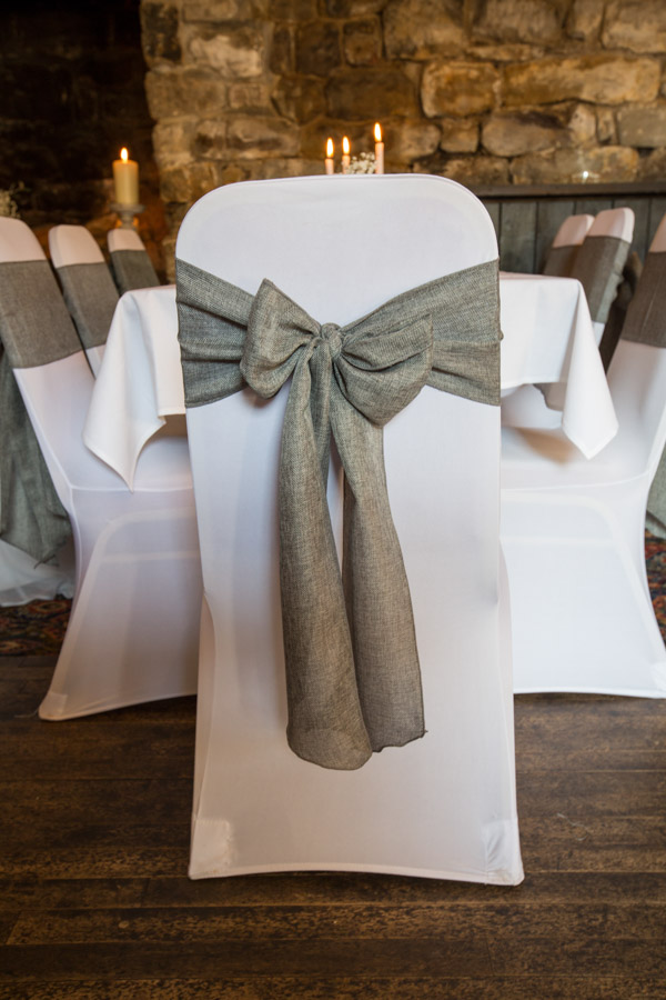 Grey fabric bow on the back of a chair at The Rockingham Arms Wedding