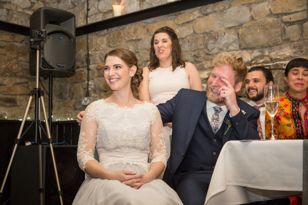 Bride and Groom laughing during speeches at The rockingham Arms Wentworth Wedding