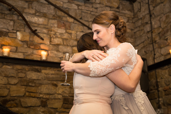 Bride hugging her bridesmaid