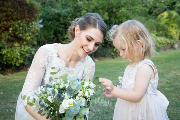 Bride with flower girl in the grounds of The Rockingham Arms Wentworth