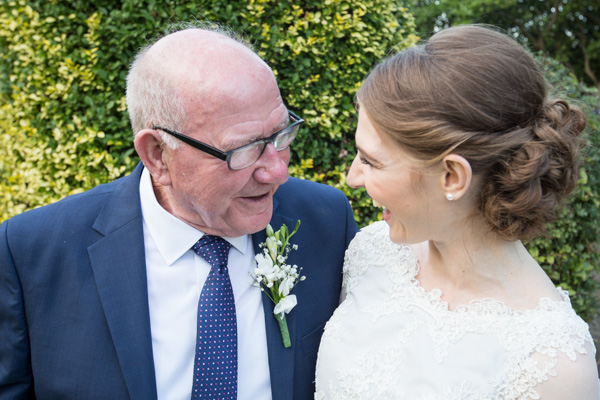 Bride laughing with her grandfather at The Rockingham Arms Wedding Wentworth