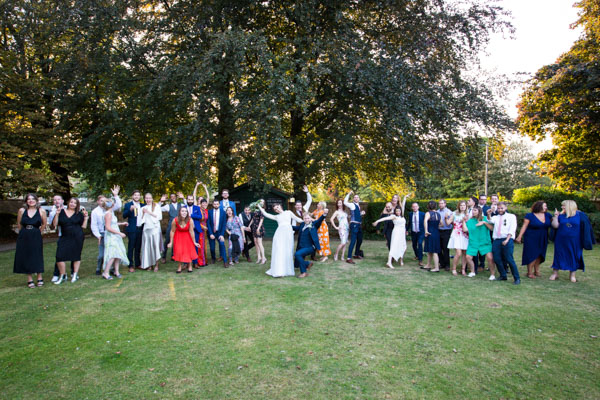 WEdding guests striking a pose in the grounds of the Rockingham Arms Wedding