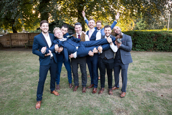 Groomsmen holding the groom in the air at The Rockingham Arms Wedding