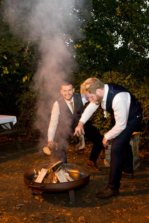 Groomsmen and Groom making a fire in a new firepit