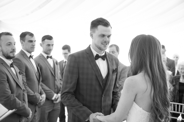 Bride and groom looking at each other during wedding ceremony