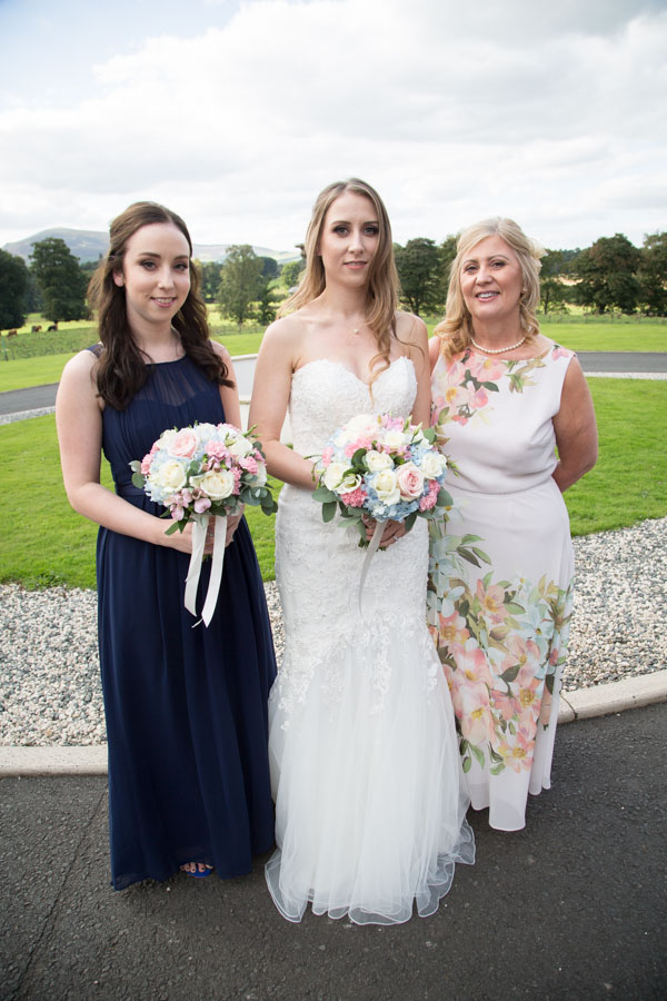 Bride with her Mum and Sister by the fountain at Cornhill Castle