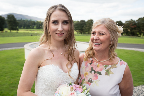 Bride with her Mum by the fountain at Cornhill Castle wedding