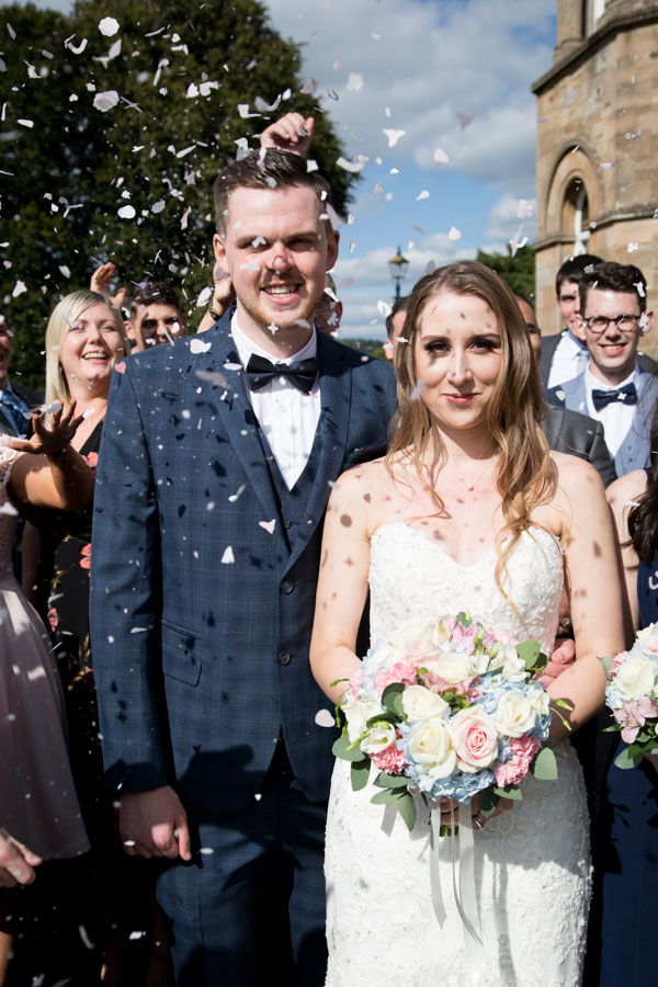 Bride and Groom with confetti in the grounds at Cornhill Castle Wedding