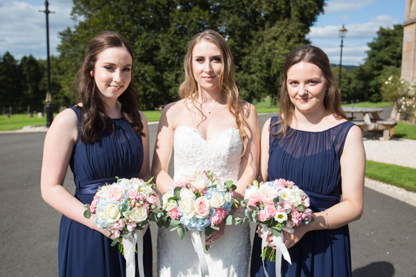 Bride and bridesmaids in the grounds of Cornhill Castle