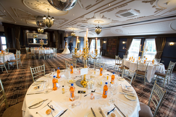 Wedding reception room laid out with irn-bru and scottish tablets