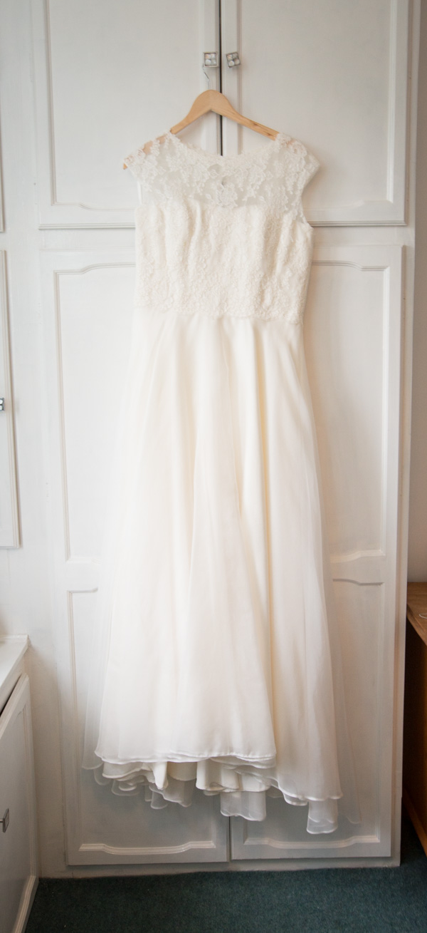 Wedding Dress before it's worn hanging on a wardrobe