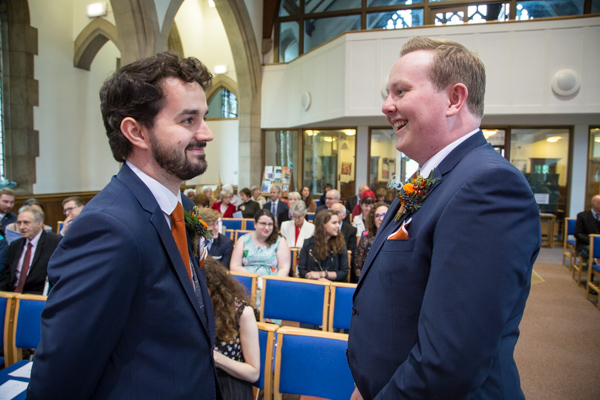 Groom and best man talking at the altar at St Andrews Church Psalter Road