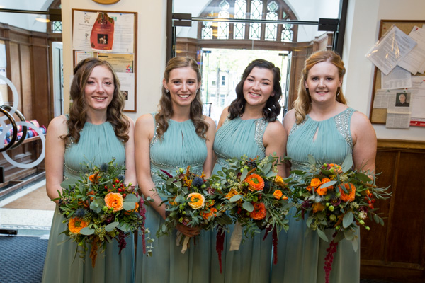 Bridesmaids in the church entrance before the ceremony