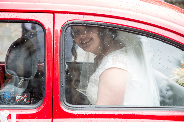 Bride arriving in a red car to St Andrews Church Psalter Road