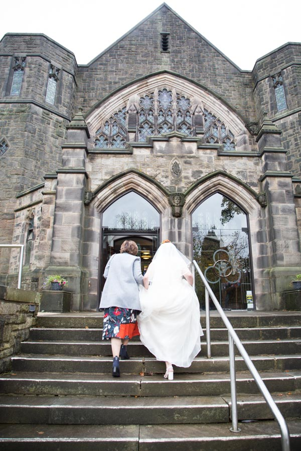 Bride and Mother of the Bride walking up the steps to St Andrews Church Psalter Road