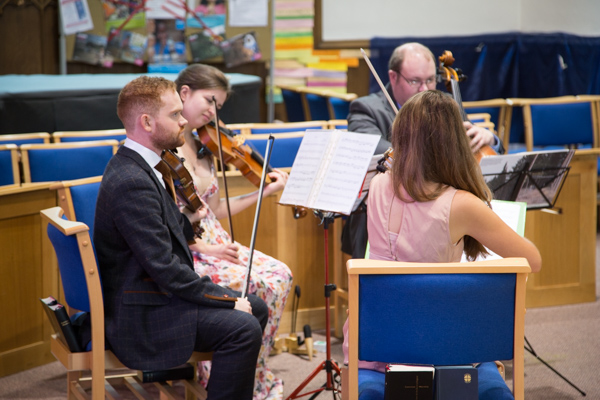 String quartet playing during a wedding ceremony at St Andrews church Psalter Road Sheffield