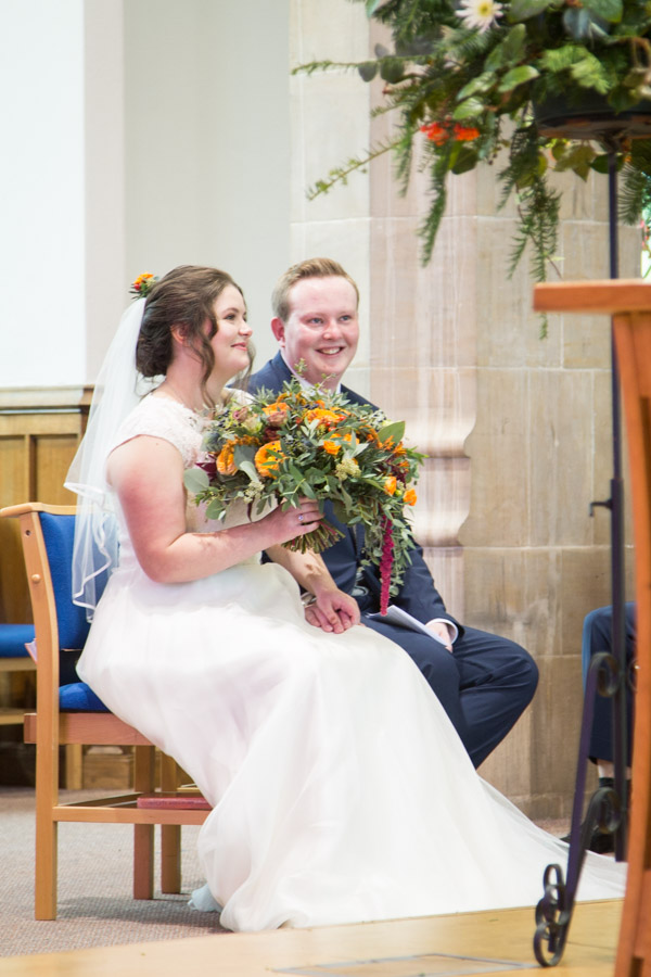 Bride and Groom smiling during their wedding ceremony at St Andrews Church Psalter Road Sheffield