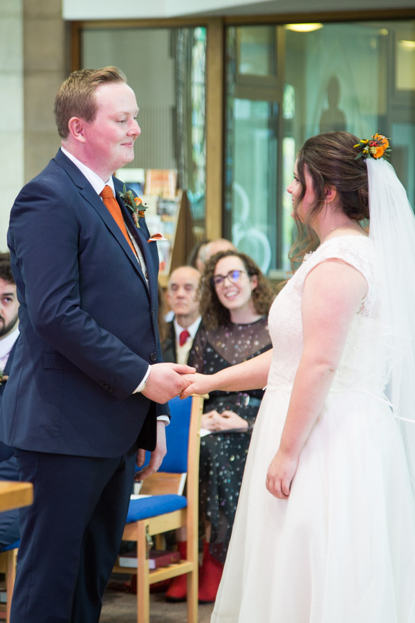 Bride and groom exchanging vows at St Andrews Church Sheffield