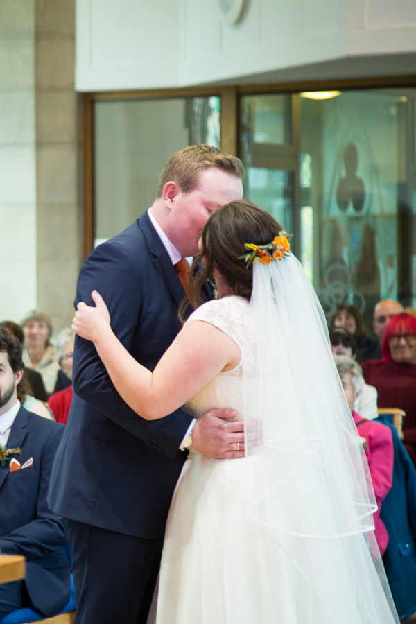 Bride and Groom first kiss at St Andrews Church Psalter Lane Sheffield