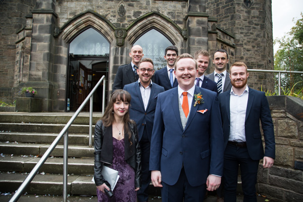 Groom with his friends outside the church on his wedding day
