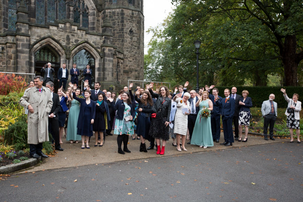Guests waving off the Bride and Groom outside St Andrews Church Psalter Lane Sheffield