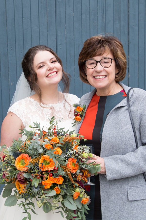 Bride and Mother of the Bride outside the barn at Horsleygate Hall Derbyshire