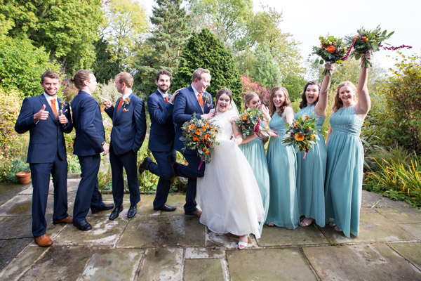 Bride and Groom with their wedding party in the grounds of Horsleygate Hall Derbyshire