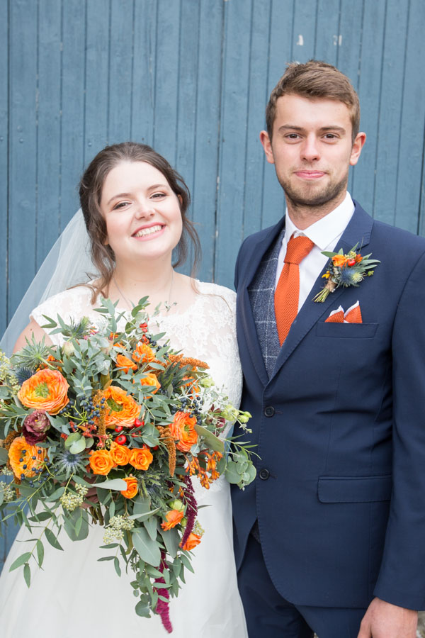Bride and her brother outside the Barn at Horselygate Hall Derbyshire width=
