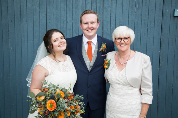 Bride, Groom and mother of the groom outside the barn at Horsleygate Hall Derbyshire