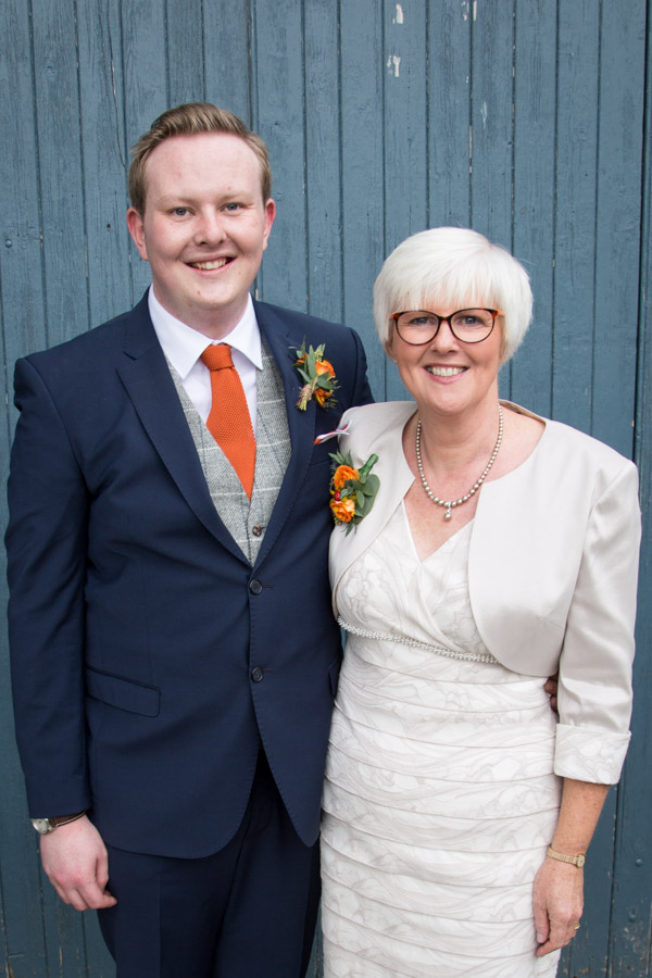 Groom and Mother of the Groom outside the blue barn at Horsleygate Hall Derbyshire