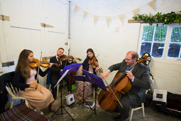String Quartet playing inside the Barn at Horsleygate Hall Derbyshire