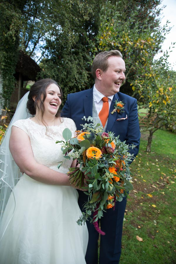 Bride and groom in the apple orchard at Horsleygate Hall Derbyshire