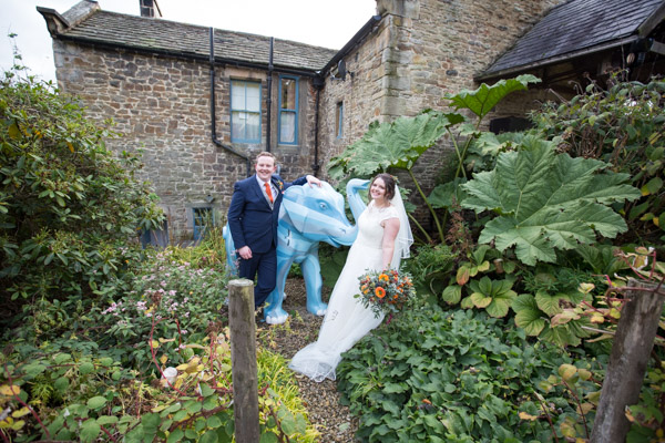 Bride and groom with the blue elephant at Horsleygate Hall Derbyshire