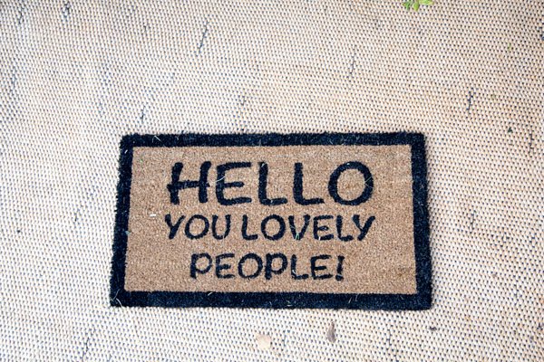 Hello you lovely people doormat at the entrance to the tipi wedding at Horsleygate Hall Derbyshire