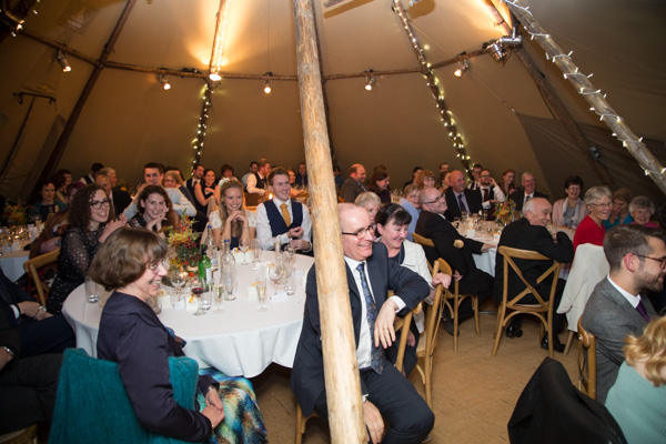 Guests laughing at Horsleygate Hall wedding