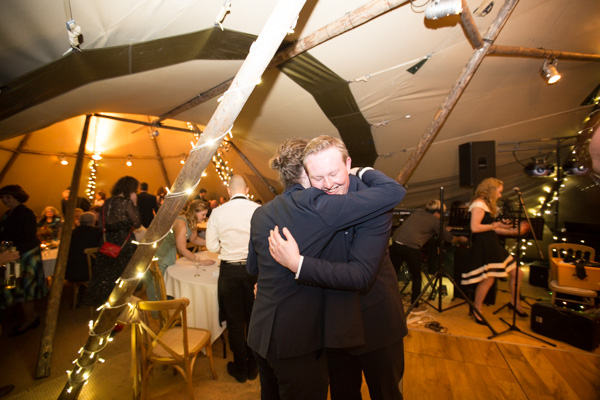 Groom hugging guests at Horsleygate Hall wedding