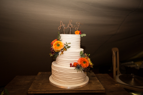 Simple wedding cake by SJ cakes with white icing and orange flowers