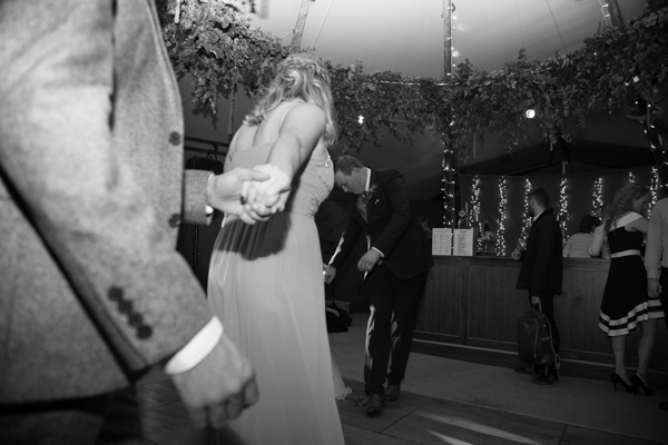 Guests walking onto the dancefloor at Horsleygate Hall wedding