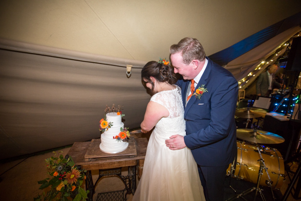 Bride and Groom cutting the cake at hosleygate Hall