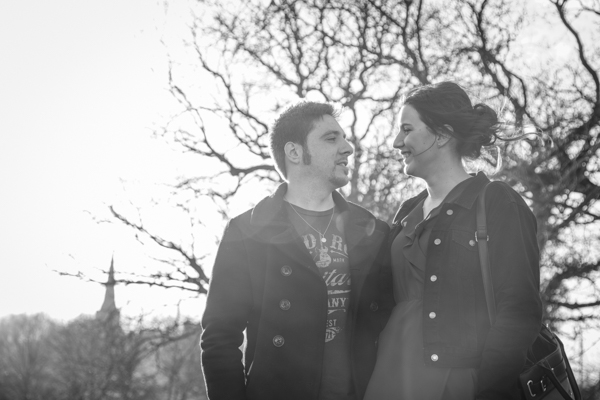 Couple standing in front of a tree with Wentworth Church in the background on their pre-wedding shoot