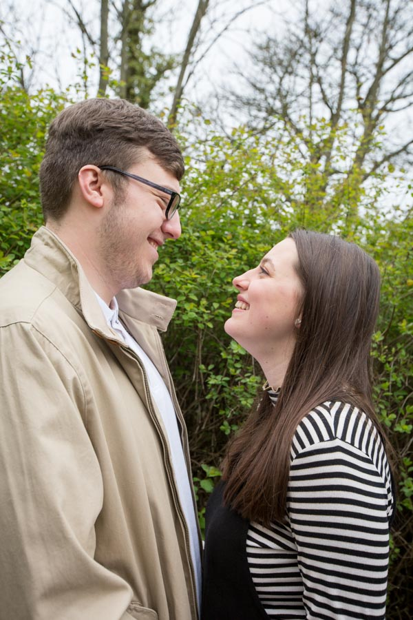 Couple look at each other smiling at Tankersley Manor