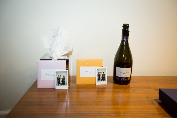 bridesmaid gifts and prosecco on a table with a box of tissues