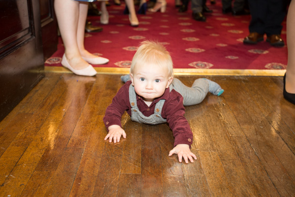Baby crawling along the floor before the ceremony at Cutlers' Hall Sheffiled