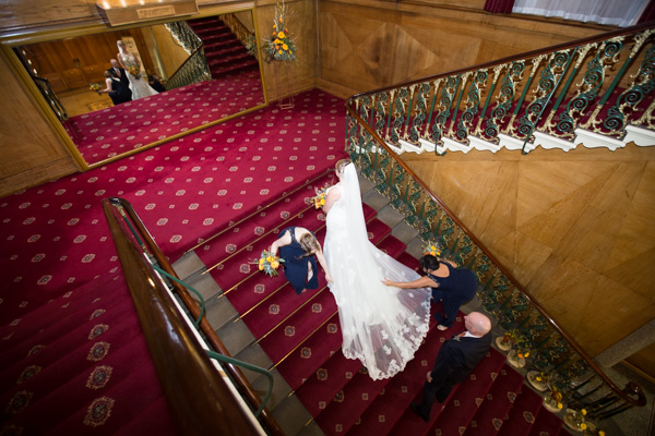 Bridesmaids helping the bride upstairs at Cutlers' Hall Sheffield