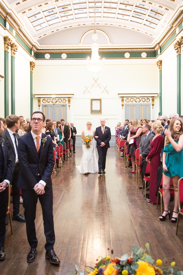 The bride and her father walking down the aisle at Cutlers' Hall Sheffield