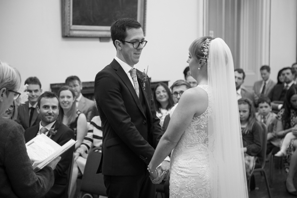 Bride and Groom look at each other during the wedding ceremony at Cutlers' Hall Sheffield