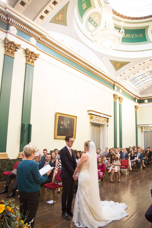 Bride and Groom looking at each other during the wedding ceremony at Cutlers' Hall Sheffield