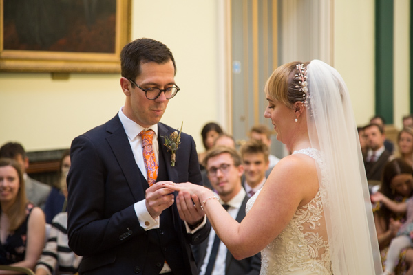 Bride and Groom exchanging rings at Cutlers' Hall Sheffield